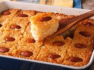 Рецепта Басбуса - Арабски сладкиш тип реване с брашно, кисело мляко, бадеми, канела и захарен сироп